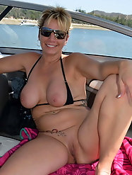 Raunchy mature mistress is baring it all on picture