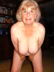 Mature woman is posing seminaked indoor