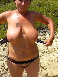 Good-looking older bitch is revealing her breasts