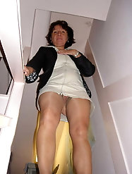 Voluptuous mature lass is touching herself