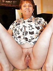 Granny spreads and shows hairy pussy